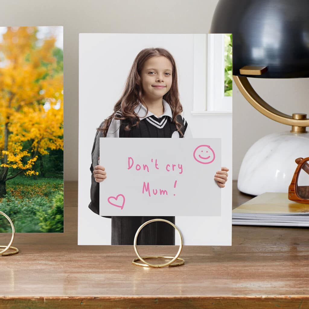 Capture and print a portrait of your child on the first day of school with a funny sign for Mum or Dad.
