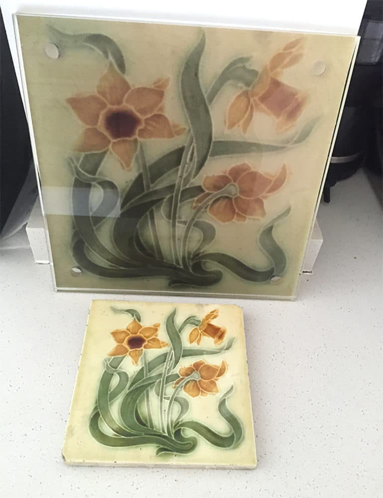 Same floral print on a tile and laminated wall art