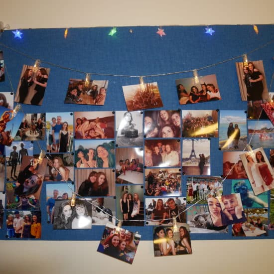 Print photos of friends and family to decorate your room with
