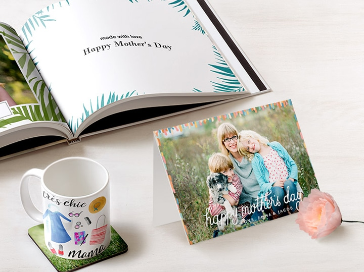 Mother's Day photo book, card and mug on a table