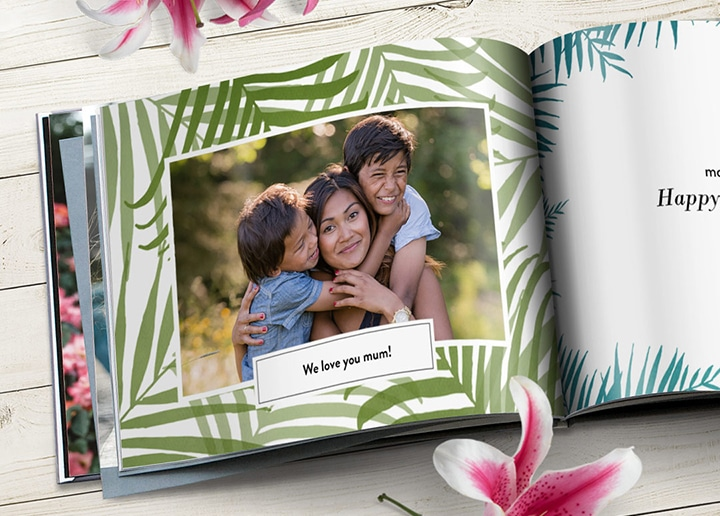 Open photo book showing photo of mother and children