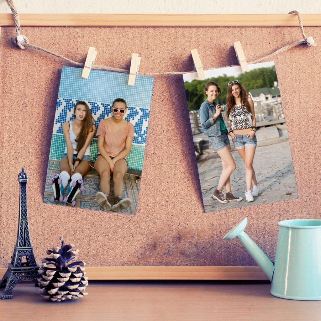 Showcase photos of your friends pegged from string or ribbon