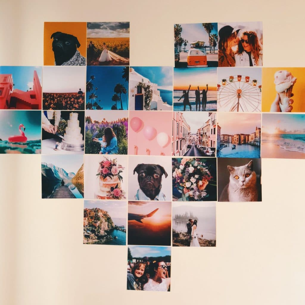 Create a gallery wall of prints grouped into a heart shape
