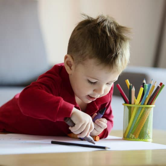 Little boy colouring